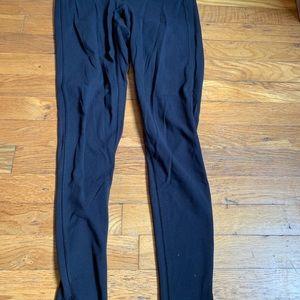 Black Athleta leggings, split bottom hem